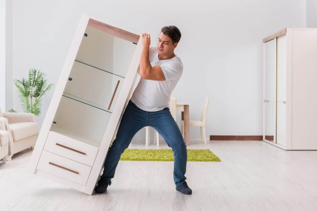 man moving furniture
